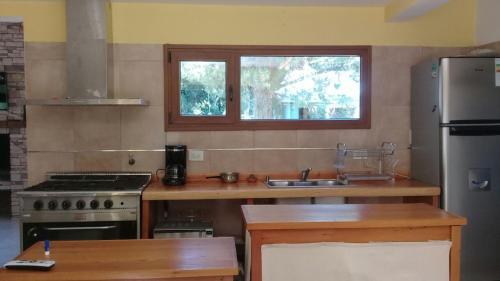 Una cocina o kitchenette en Casa en Llao Llao