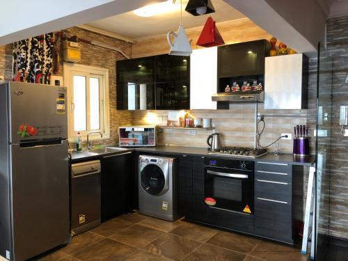 Küche/Küchenzeile in der Unterkunft Blue Bay Beach
