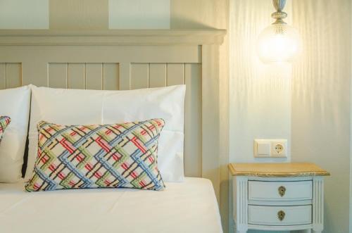 Palm Studios tesisinde bir odada yatak veya yataklar