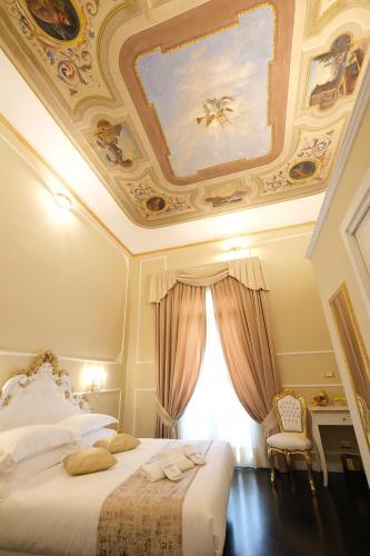 Een bed of bedden in een kamer bij B&b Kingsman