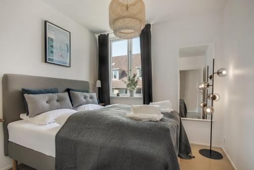A bed or beds in a room at NORD Collection - 4 BR Hotel Apartment