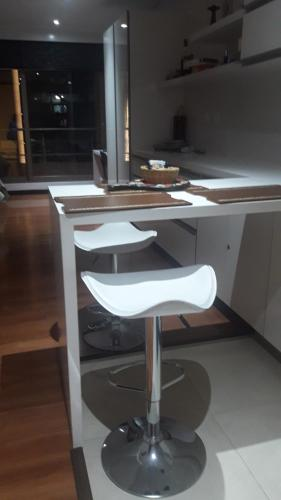 A kitchen or kitchenette at LOFT CENTRO INTERNACIONAL