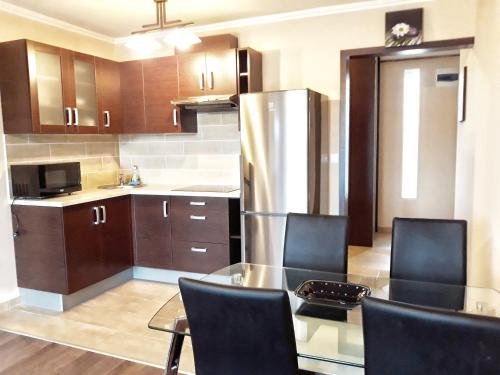 A kitchen or kitchenette at Central Holiday Apartment