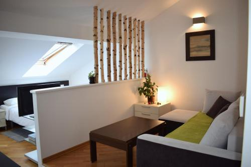 A seating area at Bright apartment 1 in the heart of Prague