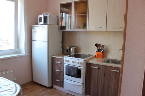 Кухня или мини-кухня в Квартира в центре Новгородский 113