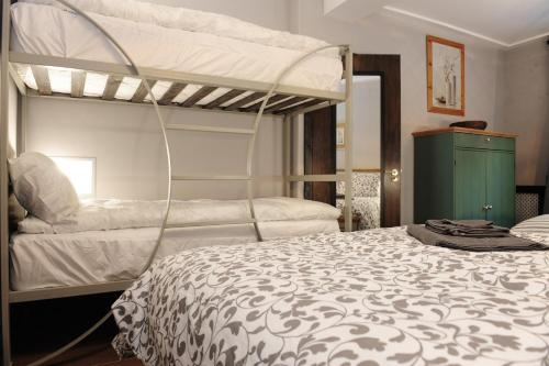 A bunk bed or bunk beds in a room at Talbot Coach House