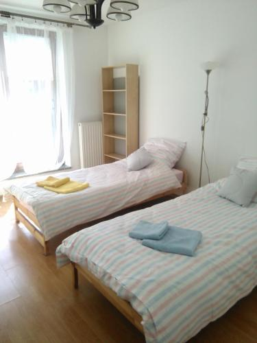 A bed or beds in a room at ICE, Dworska Pretty Apartment
