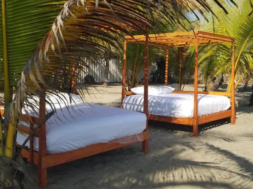 Cama o camas de una habitación en Nichos Beach Villas