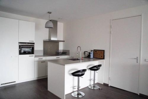 A kitchen or kitchenette at Calypso apartment City Center + Parking