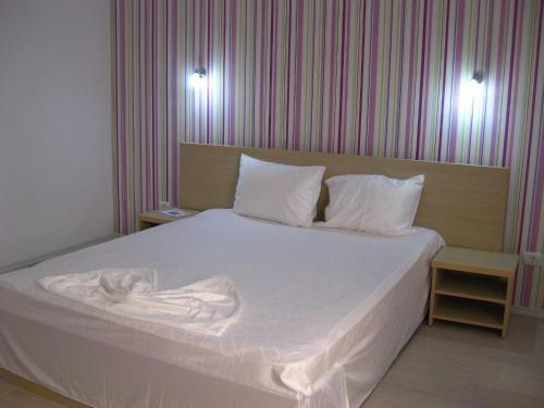 Un pat sau paturi într-o cameră la Vila Malva
