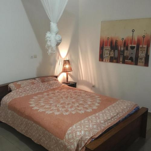 A bed or beds in a room at Residence Schaka Miniere