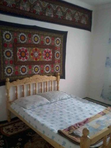 A bed or beds in a room at Guest House Mutabar