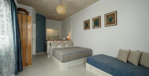 A bed or beds in a room at Vallas Apartments & Villas