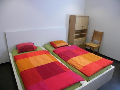 Cama o camas de una habitación en City Center Apartments