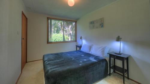 A bed or beds in a room at The Broken Banyan