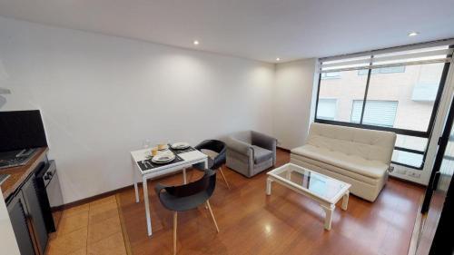 A seating area at Apartamentos chico 93