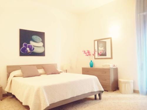 A bed or beds in a room at La casa di Francesca