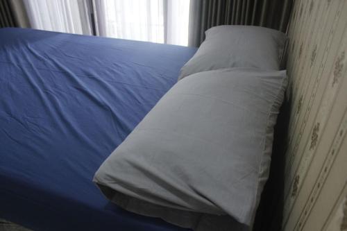 Tempat tidur dalam kamar di Aren Home