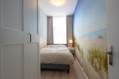 Postelja oz. postelje v sobi nastanitve Badhuisweg Apartments