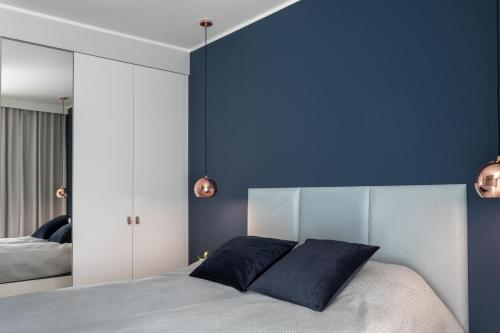A bed or beds in a room at Apartament CLIF
