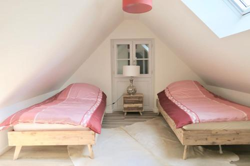 A bed or beds in a room at Country House - La Valentrée