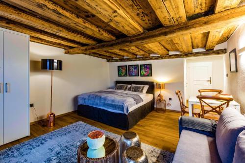 Ein Bett oder Betten in einem Zimmer der Unterkunft APT. STONE-LODGE