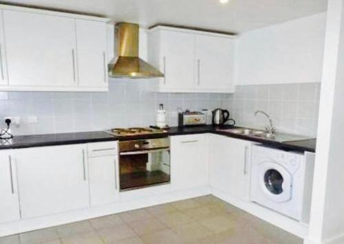 A kitchen or kitchenette at Principality Apartment