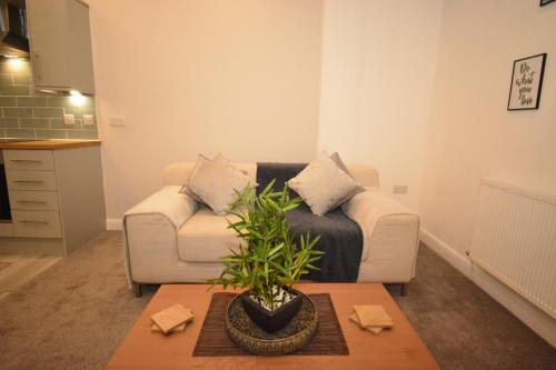 A seating area at F.G. Apartments Winckley Square 1