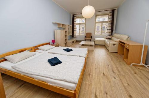A bed or beds in a room at Residence Jagellonska