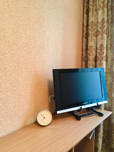 A television and/or entertainment center at Hotel Zvezdny