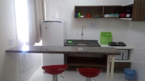 A kitchen or kitchenette at Via Caldas L'acqua I
