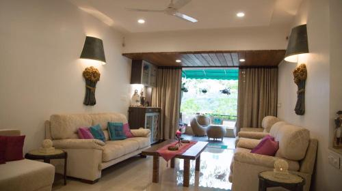 A seating area at Lavasa Luxury Deck Apartment with View
