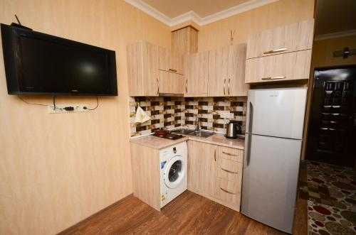 A kitchen or kitchenette at Apartment with sea view on 22 floor