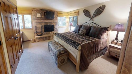 A bed or beds in a room at Tamarack Townhouses, A Destination Residence