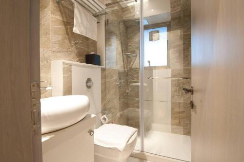 A bathroom at Orbit Home Luxury Service Apartments