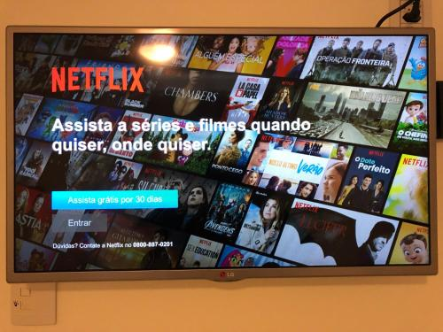 A television and/or entertainment centre at Sweet Home Porto Alegre