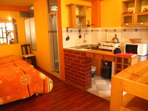 A kitchen or kitchenette at Casa De Mama Cusco - The Treehouse