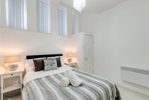 A bed or beds in a room at Old Bill Apartments Anfield Liverpool