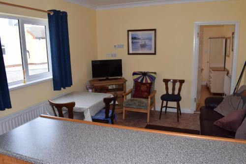 A seating area at An Crugan Cottage