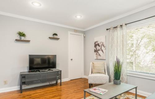 A television and/or entertainment center at Amazing Midtown Location by Piedmont Park