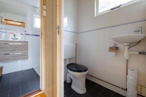 Um banheiro em Centre beach lodge