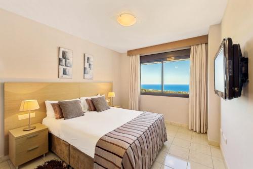 A bed or beds in a room at Macdonald La Ermita Resort