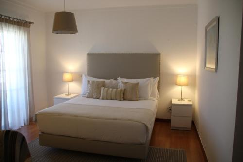 A bed or beds in a room at Casa Mira Ria by Cozy Homes