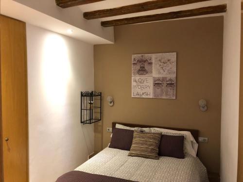Llit o llits en una habitació de Top Barcelona Apartments
