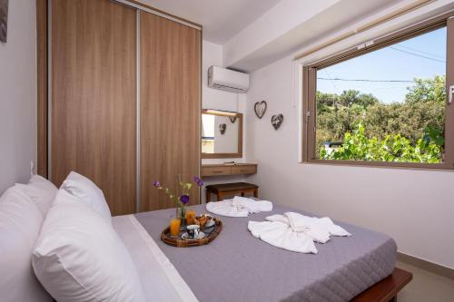 A bed or beds in a room at Theaktis Resort