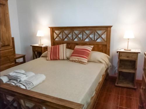 Una cama o camas en una habitación de Alojamiento Las Retamas