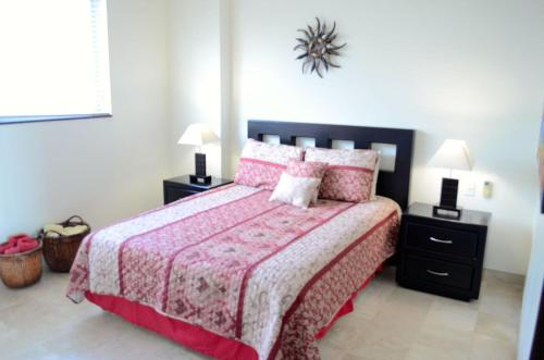 A bed or beds in a room at Minitas PP 2A 2 BR by Casago