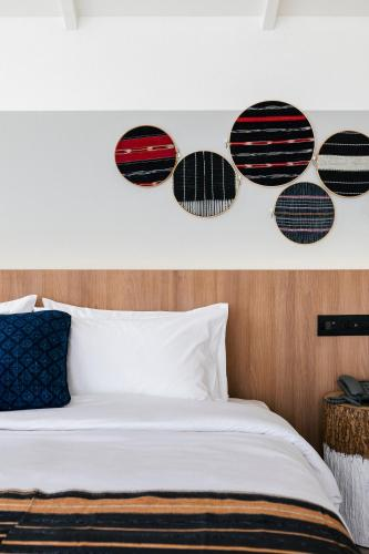 A bed or beds in a room at HOMM Boutique Hotel