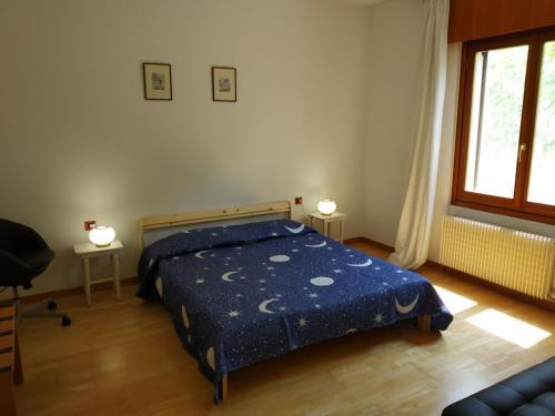 Postel nebo postele na pokoji v ubytování VILLA FAMIGLIA GAMBA
