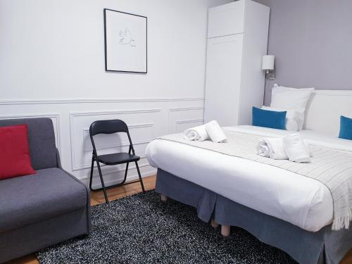 A bed or beds in a room at Apartment Quartier Latin - Monge
